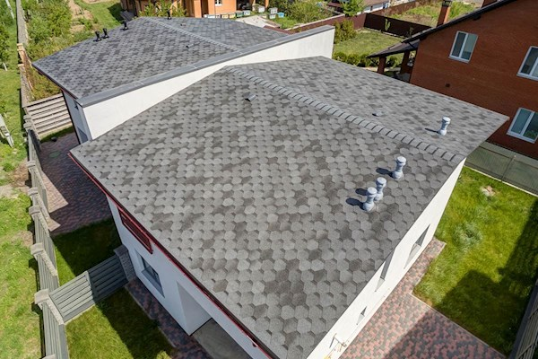 Apex hexagonal roof shingles in grey on roof