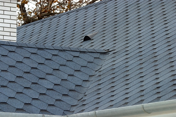 roof shingles in hexagonal design installed on pitched roof